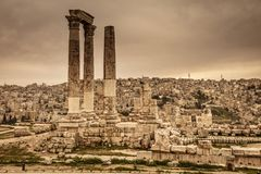 Citadel of Amman. Detail of the columns located in the citadel of Amman located atop Jabal Al Qal`a, with the background of the old city. Jordan royalty free stock photography