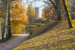 Citadel in autumnal old park , Cesis Stock Photo