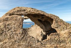Calvi in Corsica viewed through a hole in a rock Royalty Free Stock Photo
