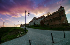 Citadel of Brasov at sunset, landmark of Brasov. The Citadel is part of Brasov's outer fortification system (Transylvania, Romania Stock Images