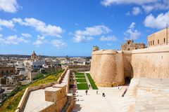 Citadel buildings and city rooftops, Victoria, Gozo. Fortified buildings and landscaped gardens of the old moat within the citadel with views towards the city Stock Photography