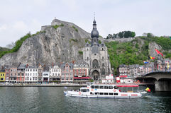 Citadel and Collegiate Church of Notre-Dame along the river Meuse, Dinant. The citadel and Collegiate Church of Notre-Dame on the banks of the River Meuse in Stock Images