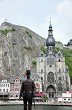Citadel and Collegiate Church of Notre-Dame along the river Meuse, Dinant. The Citadel and Collegiate Church of Notre-Dame along the river Meuse with Statue of Royalty Free Stock Image