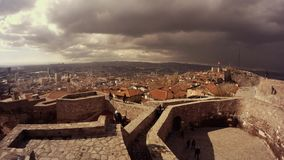 Citadel Hisar courtyard tourists view ancient town houses with tile roofs cloudy day Ankara stock video footage