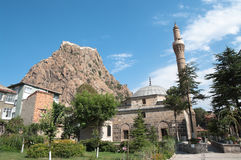 Citadel And Mosque In Afyon, Turkey. Rock topped by kale or Hisar (citadel) as a colossus dominates Afyon, Turkey Stock Photos