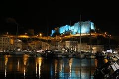 Citadel and port of Bonifacio Corsica by night royalty free stock photos