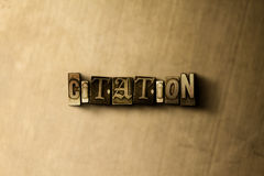 CITATION - close-up of grungy vintage typeset word on metal backdrop Royalty Free Stock Image