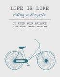 Citationstecken: Liv är som att rida en cykel Att hålla din jämvikt måste du hålla att flytta sig Royaltyfria Bilder