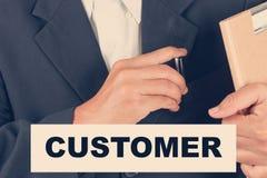 Citazioni del cliente - filtro dall'uomo di affari fondo-retro Fotografia Stock Libera da Diritti