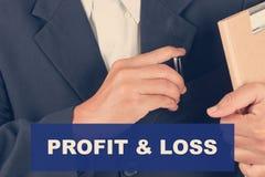 Citazioni di perdita & di profitto - fondo dell'uomo di affari Fotografie Stock