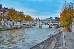 Cite island on a bright fall day in Paris Royalty Free Stock Photo