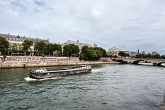 Cite Island View from Seine Riverside. Paris, France - August 16, 2017. View of medieval Cite island and Pont au Change bridge from Seine riverside. Popular stock photos