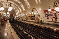 Cite subway station platform with train and luminaires in Paris. Stock Image