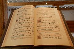 Song book and score in Citeaux Abbey chapter room. CITEAUX, FRANCE, May 21, 2018 : Copist room in Citeaux Abbey. Citeaux Abbey was founded in 1098 by a group of royalty free stock image