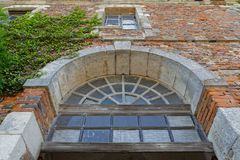 Old building entrance in Citeaux Abbey Stock Images