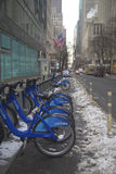 Citi bike station under snow near Times Square in Manhattan Stock Image