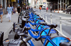 CitiBikes Midtown Manhattan in Mid Day. A row of bikes for rent on 37th Street between 5th Avenue and 6th Avenue (Avenue of the Americas) in New York City Stock Photo