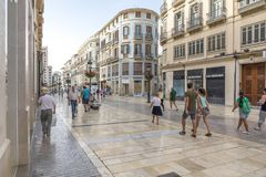 MALAGA, SPAIN - September 2nd, 2018: Tourists walking across Larios Street in the morning, during a journey in Malaga, Spain. stock image
