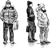 Citizens at the bus stop Stock Image