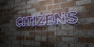 CITIZENS - Glowing Neon Sign on stonework wall - 3D rendered royalty free stock illustration. Can be used for online banner ads and direct mailers Royalty Free Stock Photography