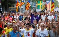 Citizens marching during a demonstration in barcelona. Citizens march carrying estelada catalan separatist flags during a demonstration supporting the catalan stock photo