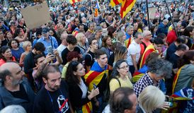 Citizens marching during a demonstration in barcelona. Citizens march carrying estelada catalan separatist flags during a demonstration supporting the catalan stock photos