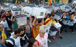 Citizens marching during a demonstration in barcelona wide. Citizens march carrying the ballot boxes used during the banned independence referendum held in stock images