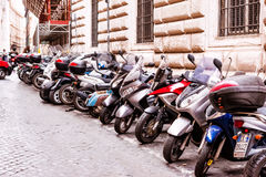 Citizens most commonly use motorcycles for everyday transportation in Rome, Italy Stock Photo