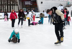 Citizens resting on winter ice rink Stock Images