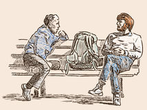 Citizens talk on a street bench Royalty Free Stock Photography