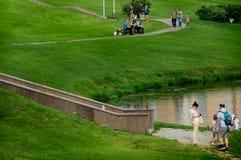Citizens walk along the embankment of the river Klyazma. royalty free stock image