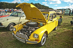 Citreon Dyanne at Roseisle. Pristine yellow vintage Citroen Dyanne at Roseisle  rally held on 22nd September 2013 Royalty Free Stock Images
