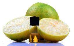 Citric acid. Bottle with lemon isolated on white background stock images