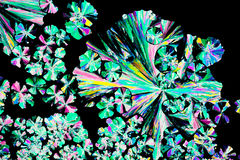 Citric acid crystals in polarized light Royalty Free Stock Images