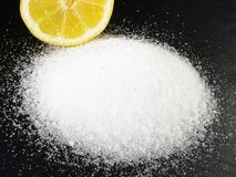 Citric Acid - Preservation and Decalcify. On black Background royalty free stock photography
