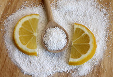Citric acid in wooden spoon with lemon. Close-up Royalty Free Stock Image