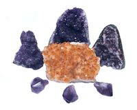 Citrine druzy cluster surrounded by amethyst druzy clusters and points Royalty Free Stock Images