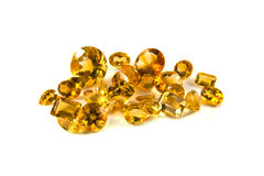 Citrine mixed facets. A grouping of mixed faceted citrine on a white background royalty free stock images