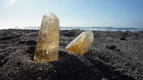 Citrine quartz on the sand Stock Image