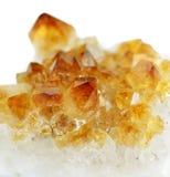 Citrine. Several crystals of citrine gemstone on white background stock image