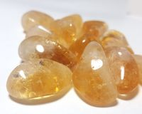 Citrine tumbled stones. Close up of citrine tumbled stones.  Citrine is called the Merchant`s Stone or the Prosperity stone and used to draw money or luck, or in Royalty Free Stock Images