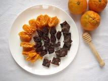 Citrino dos doces Doces no mel em uma placa, vista superior Fotografia de Stock Royalty Free