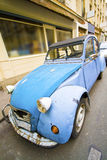 French car. Citroen blue car, parked on the streets of paris, with face view Stock Images