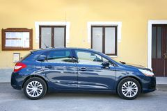 Citroen c4 new. In front of old house Royalty Free Stock Photos