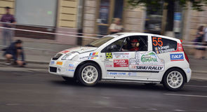 Citroen crew, Transylvania Rally 2012. A. Dragan and V. Bradateanu, on their Citroen C-2, taking part in the Unirii Square Ursus super-special trial of the royalty free stock photo