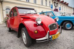 Citroen 2CV6 Club, front view, retro design car. Exhibition of v. Intage cars. Rally of old vintage vehicles anciens. Red color with chrome lights Royalty Free Stock Photography