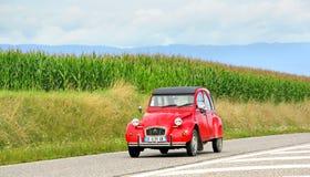 Citroen 2CV. SAINT-BLAISE, FRANCE - AUGUST 7, 2014: Retro car Citroen 2CV at the interurban road Royalty Free Stock Photography