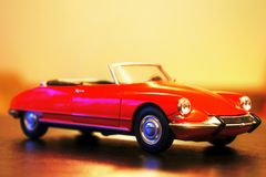 1963 Citroen DS 19 cabriolet retro car model. Red color, 1:24 scale model metal die-cast toy. Elegance, luxury convertible car Royalty Free Stock Photo