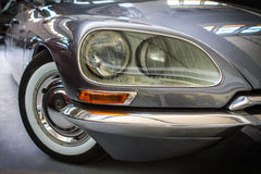 Citroen DS detail. Citroen DS, oldtimer  detail with headlights and wheel, gray Royalty Free Stock Photos