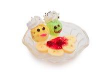 Citroen en mango kleurrijke roomijslepel met Buitensporig thema in kop Stock Fotografie